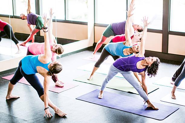 Mixed Ethnicity Yoga Class in Studio stock photo
