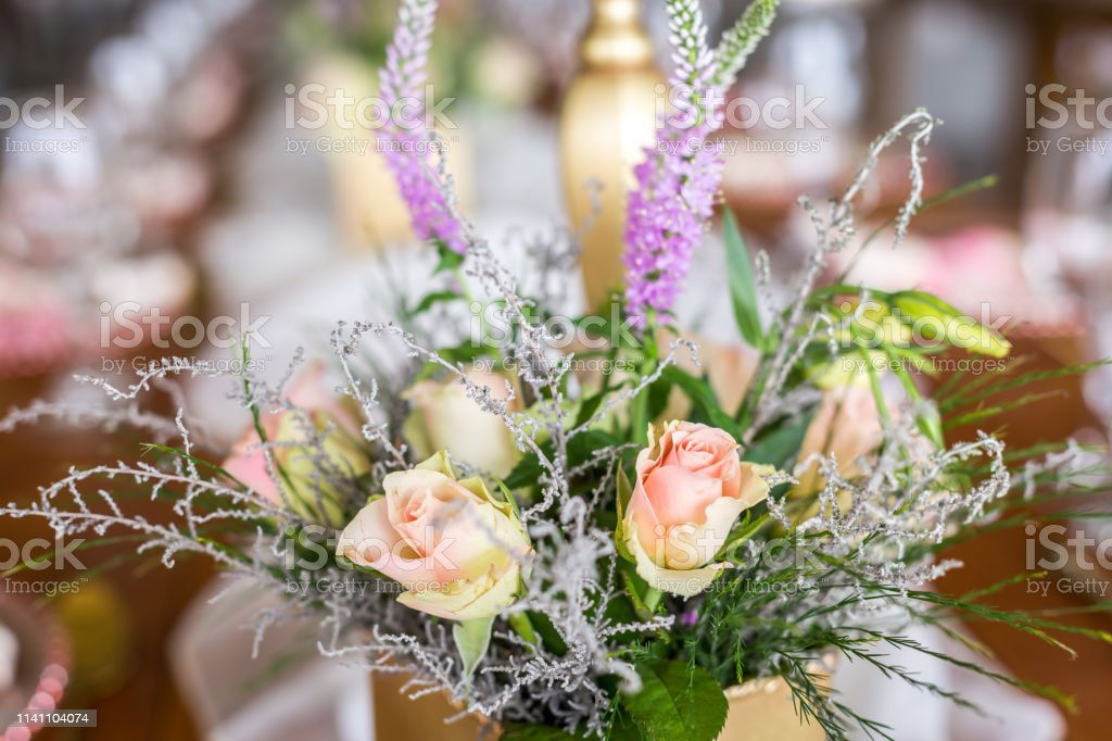 Mixed flower arrangements, bouquets, circles and table flowers at a...