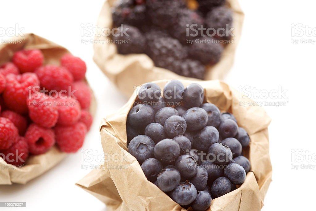mixed fresh blueberries raspberries blackberries isolated on white royalty-free stock photo