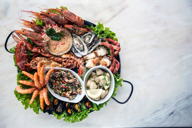 mixed fresh portuguese seafood selection gourmet set platter meal on table stock photo