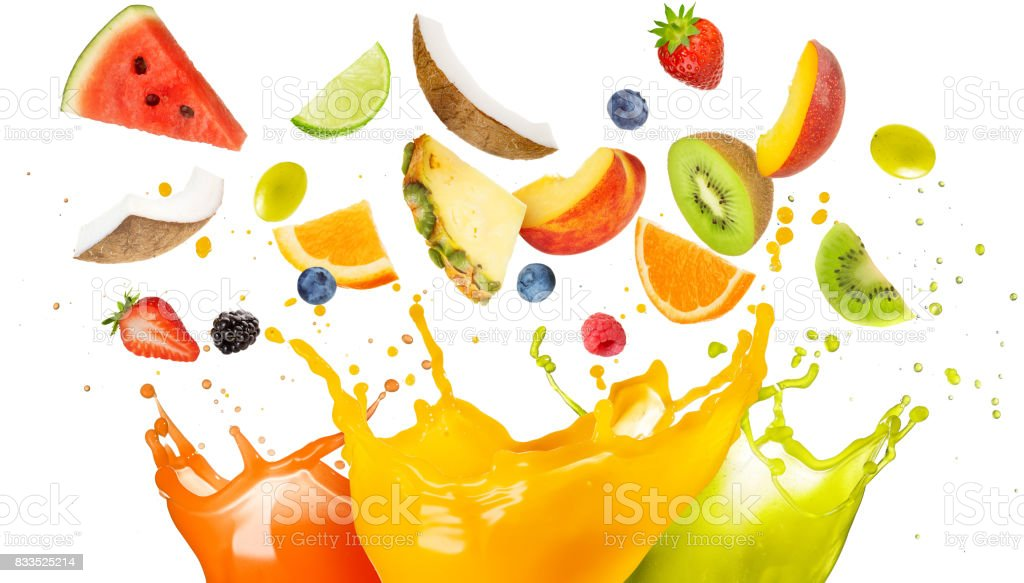 mixed fruit falling in colorful juices splashing stock photo