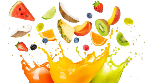 mixed fruit falling in colorful juices splashing - fruit stock photos and pictures