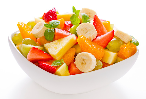Mixed fruit salad in a white square bowl
