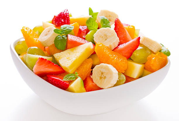 Mixed fruit salad in a white square bowl Mixed fruit salad in the bowl on white background fruit salad stock pictures, royalty-free photos & images
