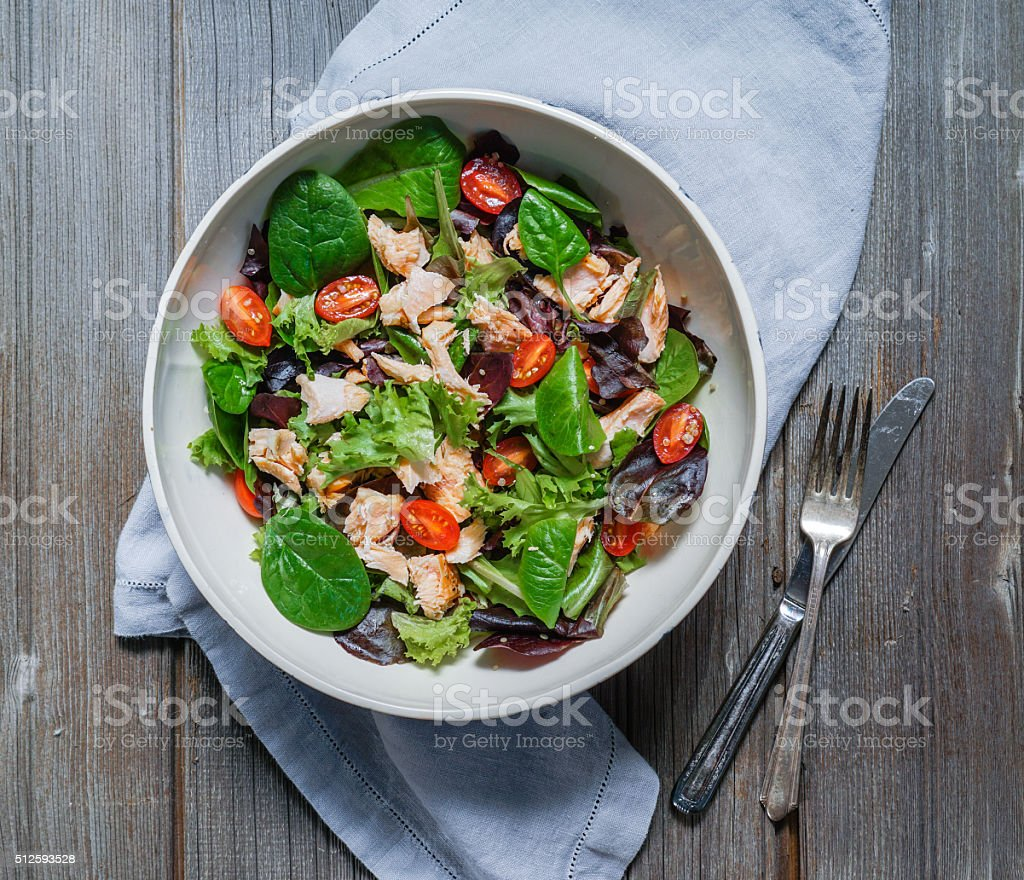 Mixed Green Salad with Grilled Salmon, Quinoa and Avocado. stock photo
