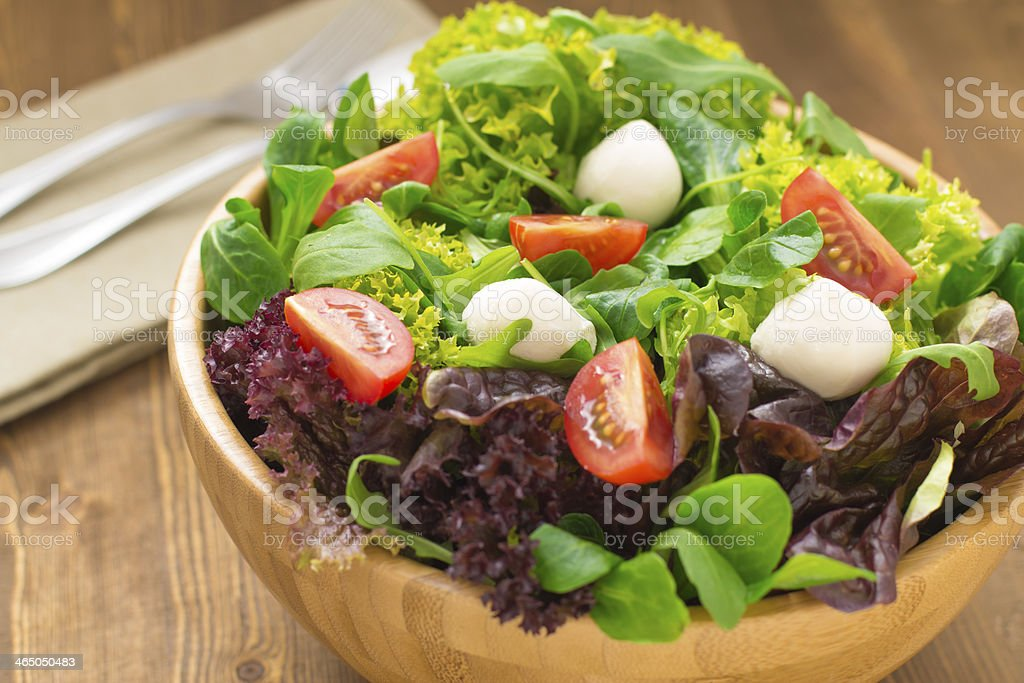Mixed green salad with tomatoes stock photo