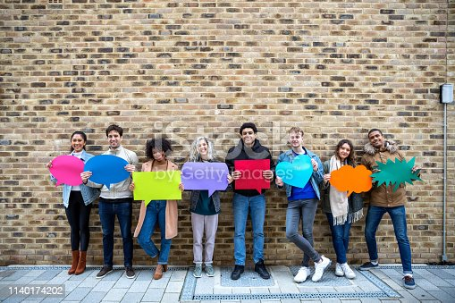 638013502istockphoto Mixed ground of people with speech bubbles 1140174202