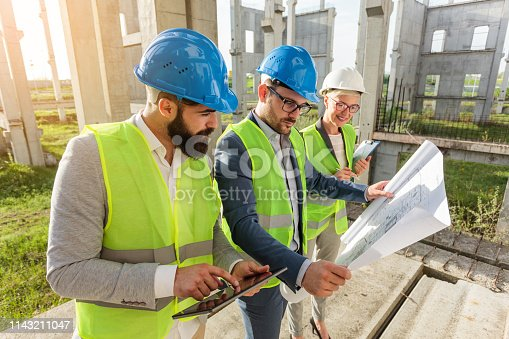 1166176793 istock photo Mixed group of young architects and civil engineers or business partners meeting on a large construction site 1143211047