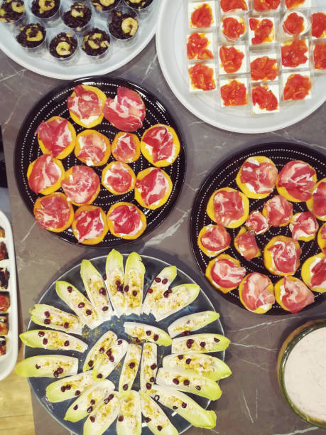 mixed italian appetizers in round plates - foto stock