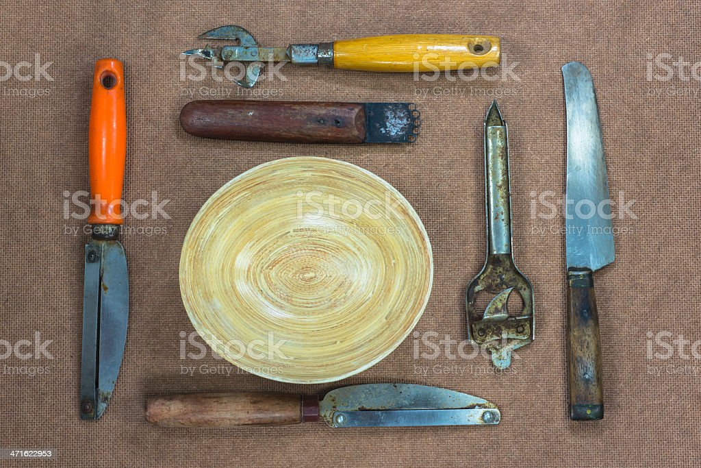 Mixed kitchen utensils on the brown background royalty-free stock photo