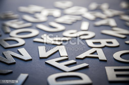 istock Mixed letters pile closeup photo 1172712218