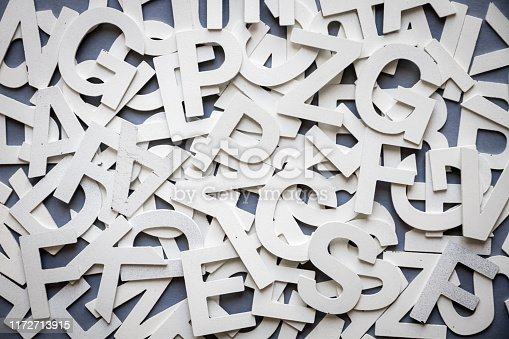 istock Mixed letters pile top view photo 1172713915