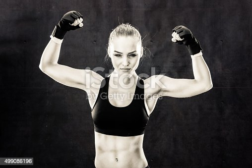 527896028 istock photo Mixed Martial Artist Celebrating a Victory In Black and White 499086196