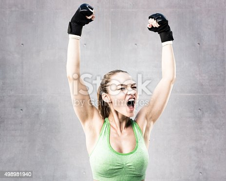 istock Mixed Martial Artist Celebrating a Victory 498981940