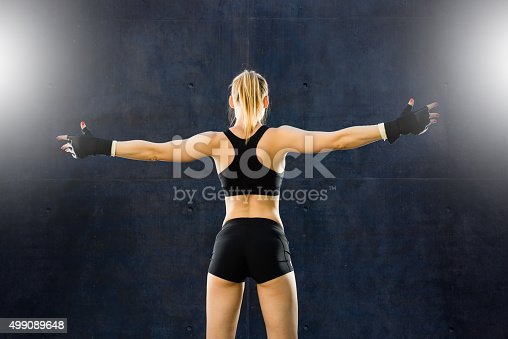 istock Mixed Martial Artist Celebrating a Victory 499089648