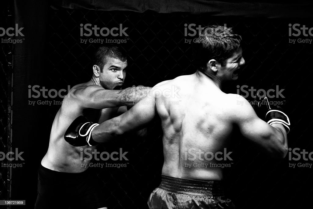 Mixed martial artists' conflict in black and white stock photo