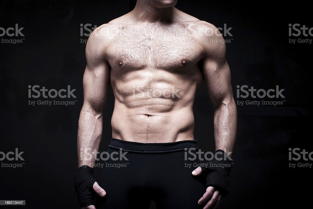 MMA - Mixed Martial Arts: muscular fighter wearing black shorts royalty-free stock photo