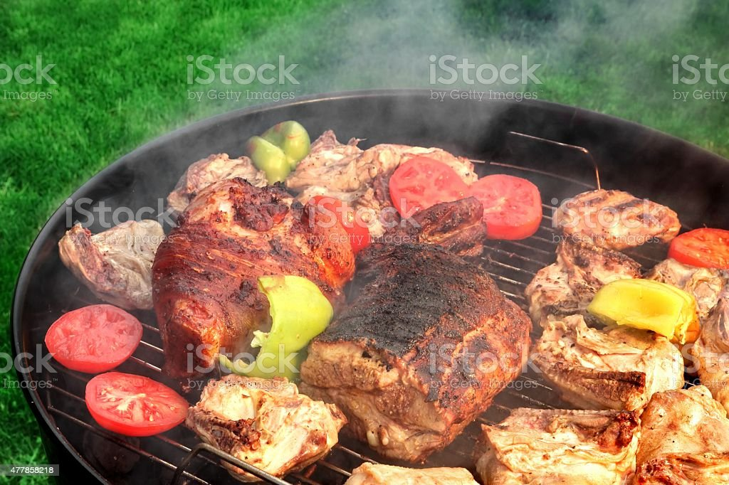 Mixed Meat And Vegetables On The Hot BBQ Grill stock photo