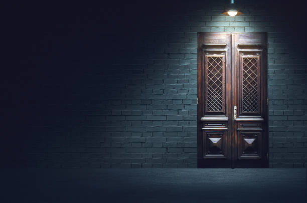 Mixed media illustration of dark evening street. Mixed media illustration of dark evening street. Old fashioned wooden door in front of white brick wall below the light of hanging metal lamp. alley stock pictures, royalty-free photos & images