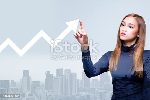 istock mixed media of a young man and a rising line chart 810397292