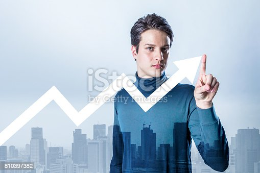 istock mixed media of a young man and a rising line chart 810397382