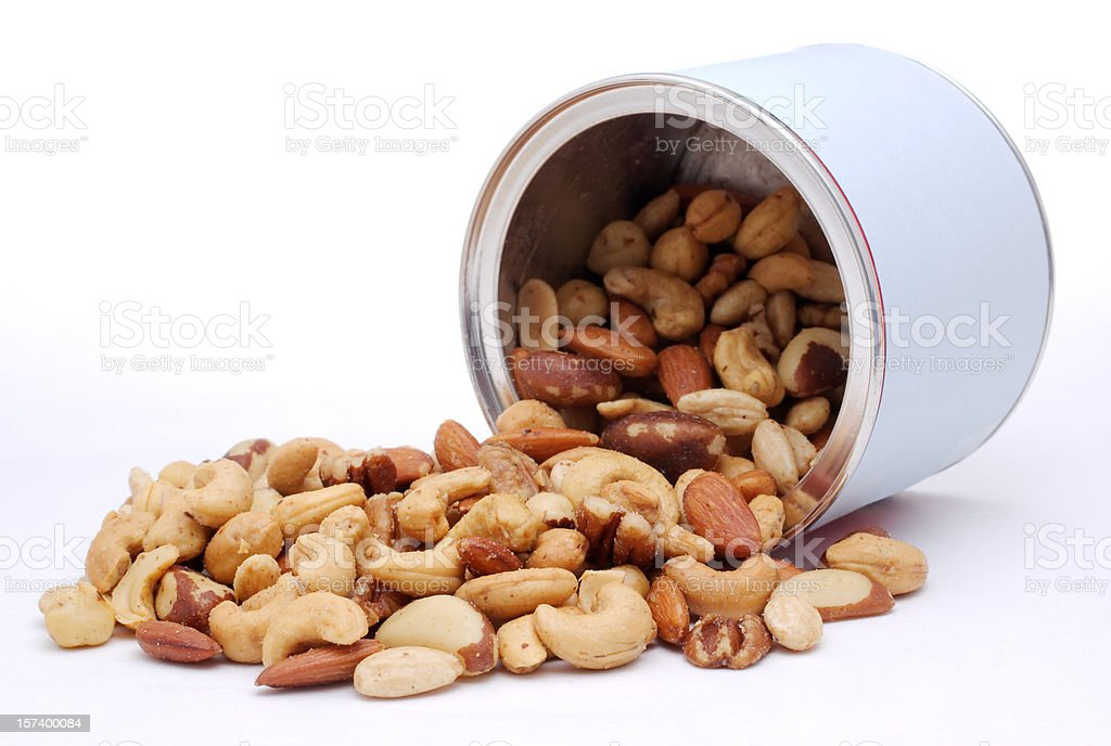 mixed nut spilling from container royalty-free stock photo