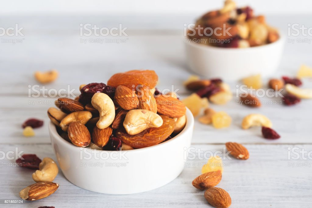 mixed nuts and dried fruit stock photo