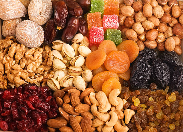 mixed nuts and dried fruits. - dried fruit stock photos and pictures