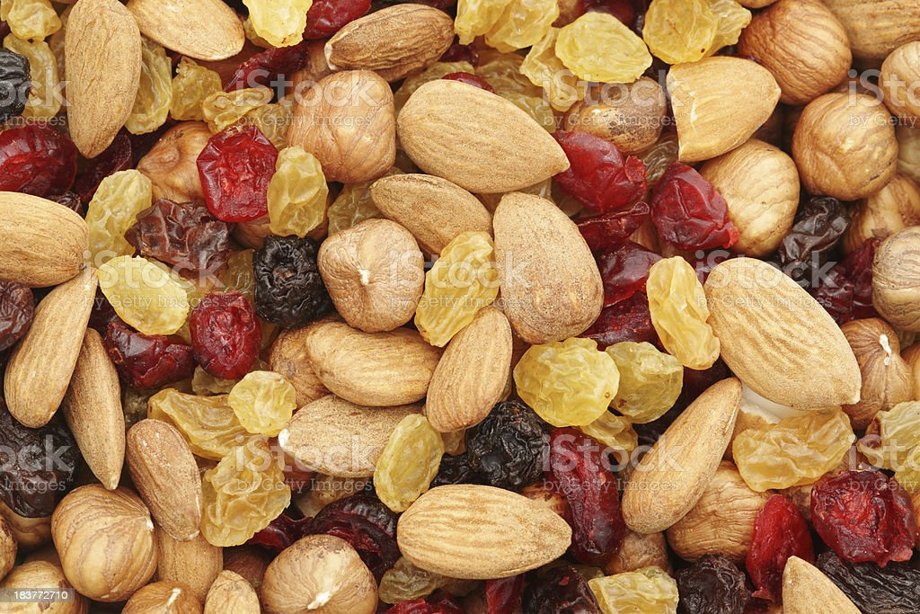 Mixed nuts and dry fruits background stock photo