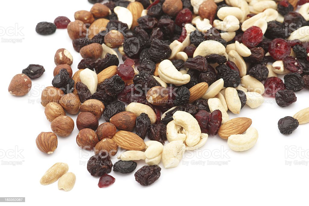 Mixed nuts and dry fruits over white background royalty-free stock photo