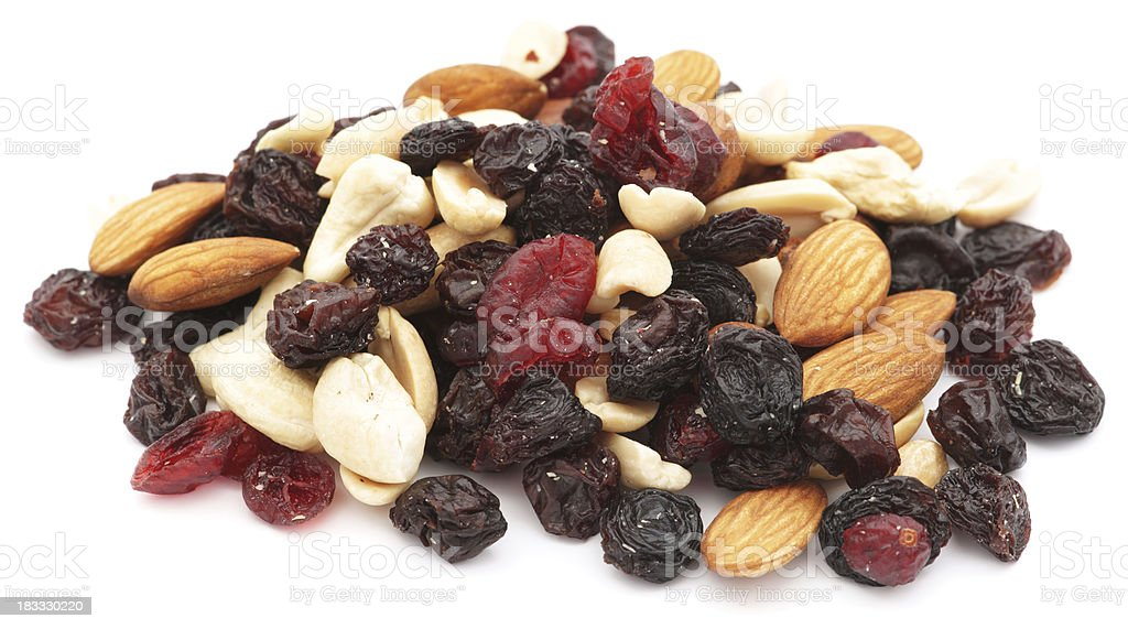 Mixed nuts and dry fruits pile isolated on white royalty-free stock photo