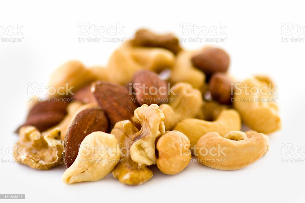 Mixed nuts close up on white background royalty-free stock photo