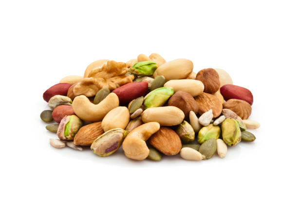 Mixed nuts heap on white background stock photo