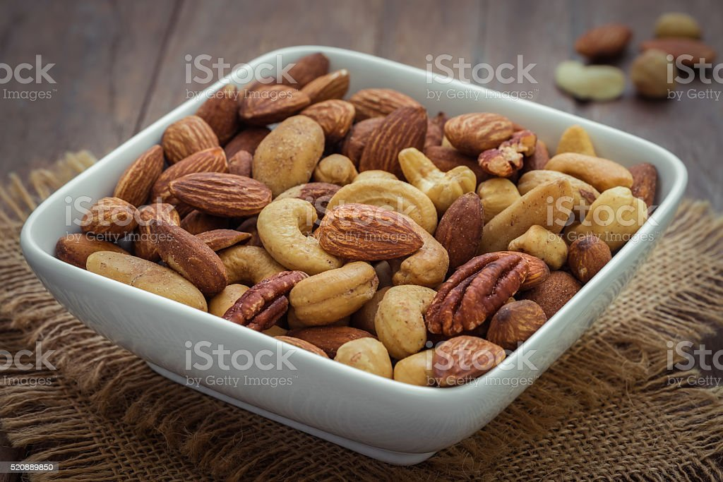Mixed nuts in bowl stock photo