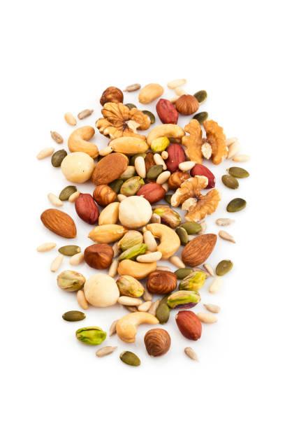 mixed nuts on white background - noci foto e immagini stock