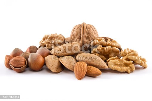 Whole, and cracked nut family on white background.