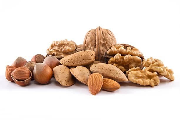 смешанная орехов - nuts стоковые фото и изображения