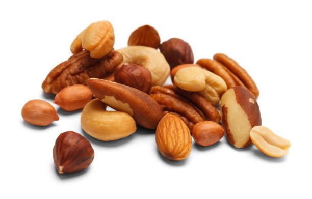 mixed nuts - nuts стоковые фото и изображения