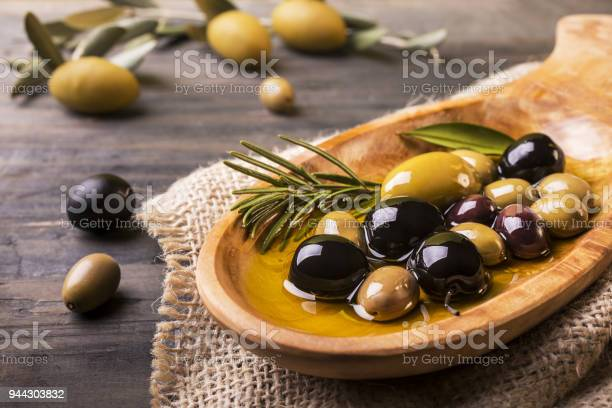 Mixed olives with rosemary in the foreground picture id944303832?b=1&k=6&m=944303832&s=612x612&h=xthz ehbponhawrzzkasn4wrgxzvvfmoimxehyhy43a=