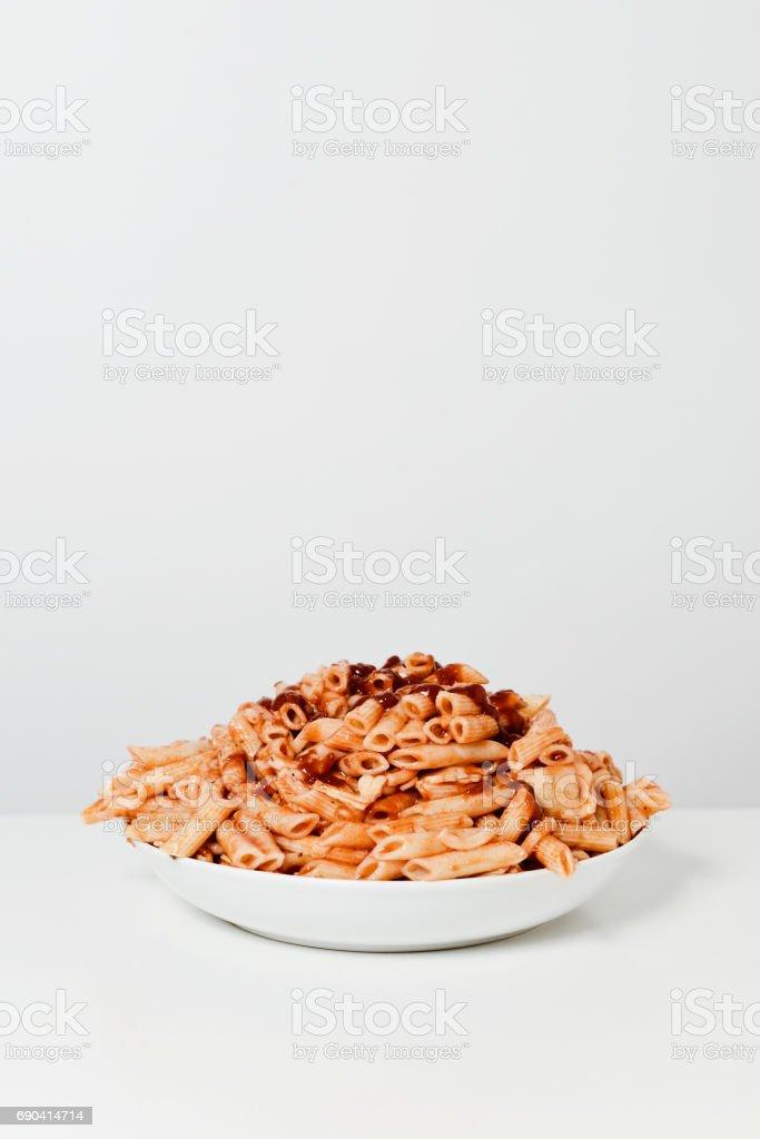 mixed pasta with tomato sauce stock photo