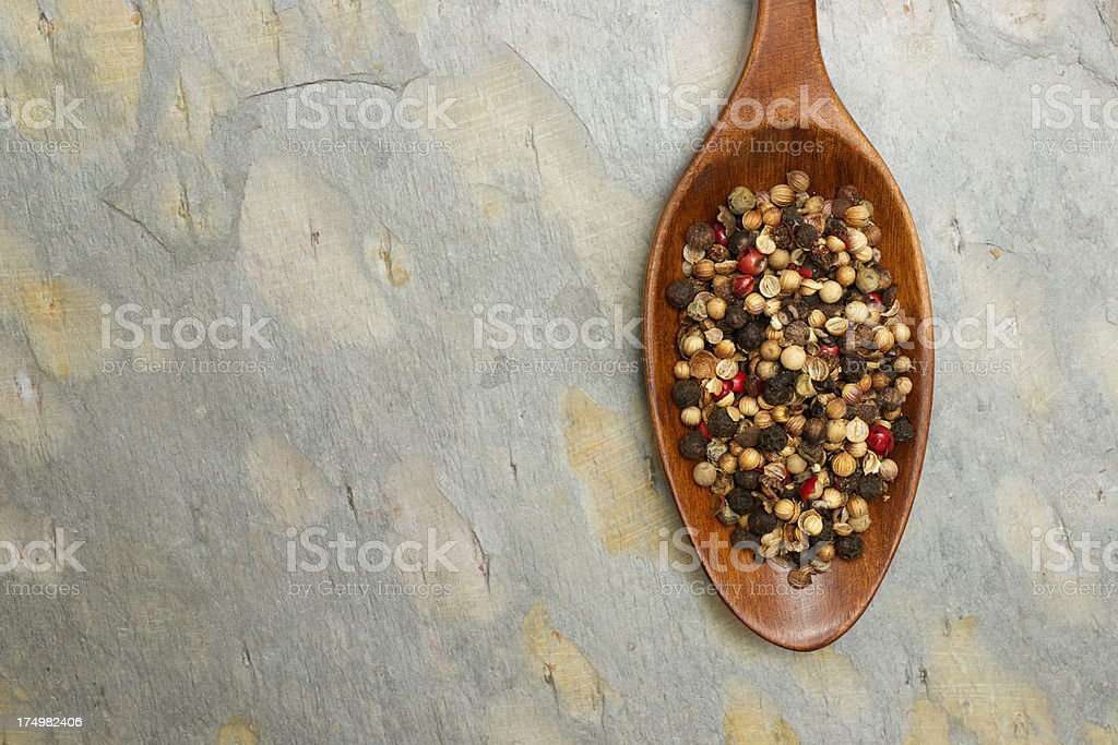 Mixed Peppercorns in Wooden Spoon royalty-free stock photo