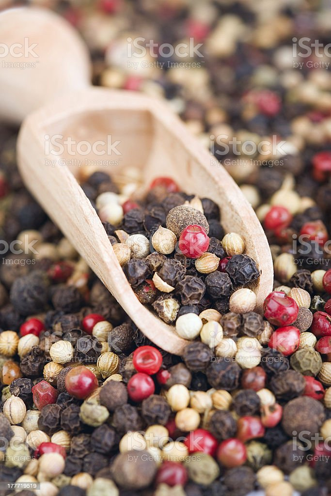 Mixed peppercorns of wooden spoon royalty-free stock photo