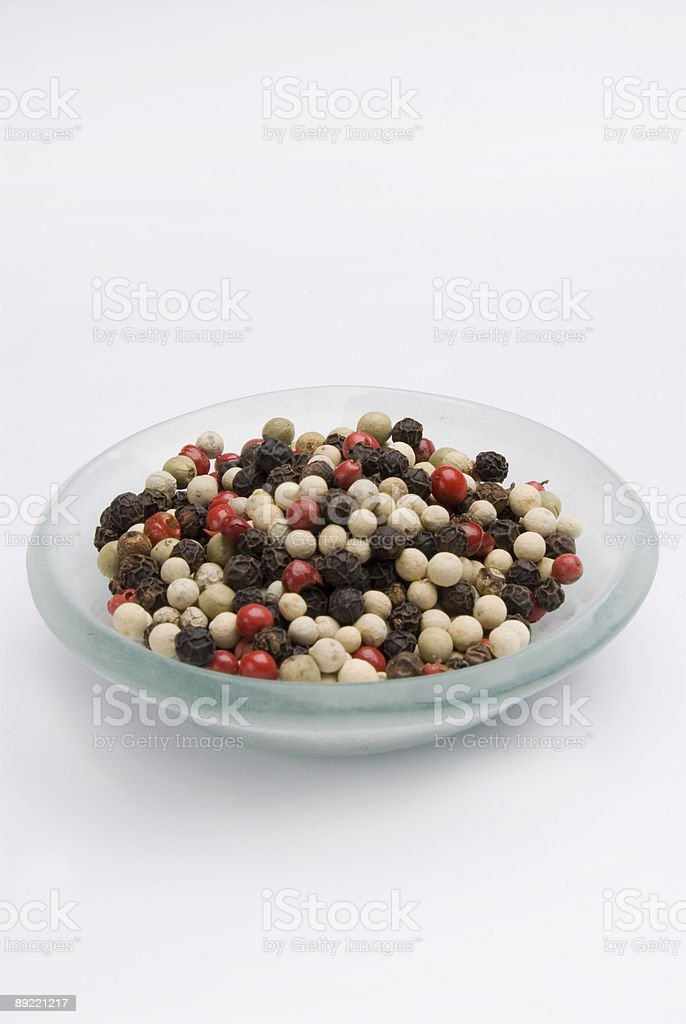 Mixed Peppers white black and pink peppercorns in glass bowl royalty-free stock photo