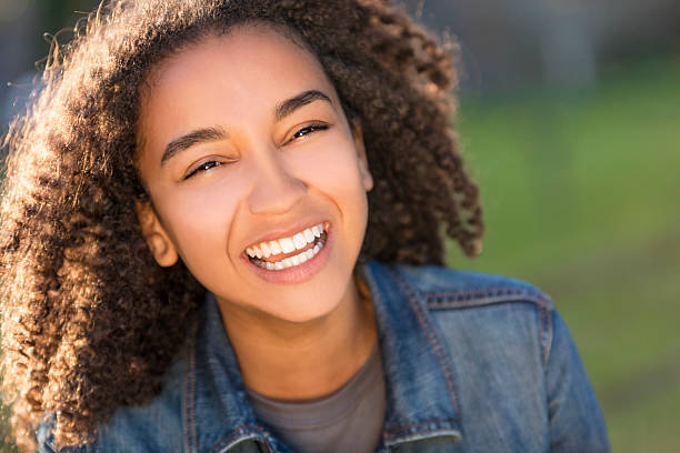 Mixed Race African American Girl Teenager With Perfect Teeth stock photo