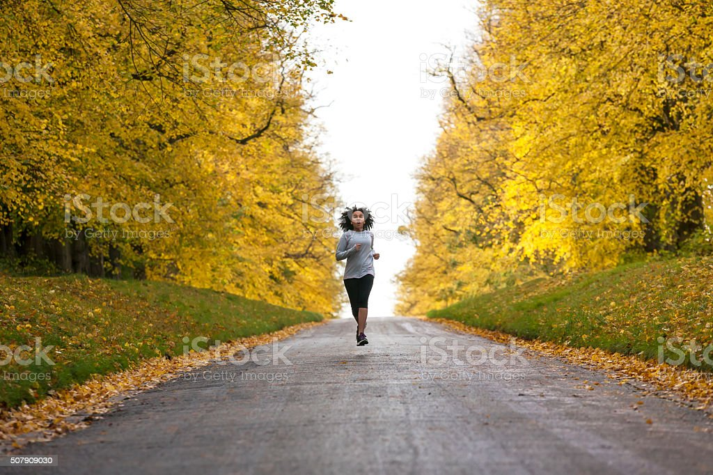 Mixed Race African American Woman Teenager Fitness Running stock photo