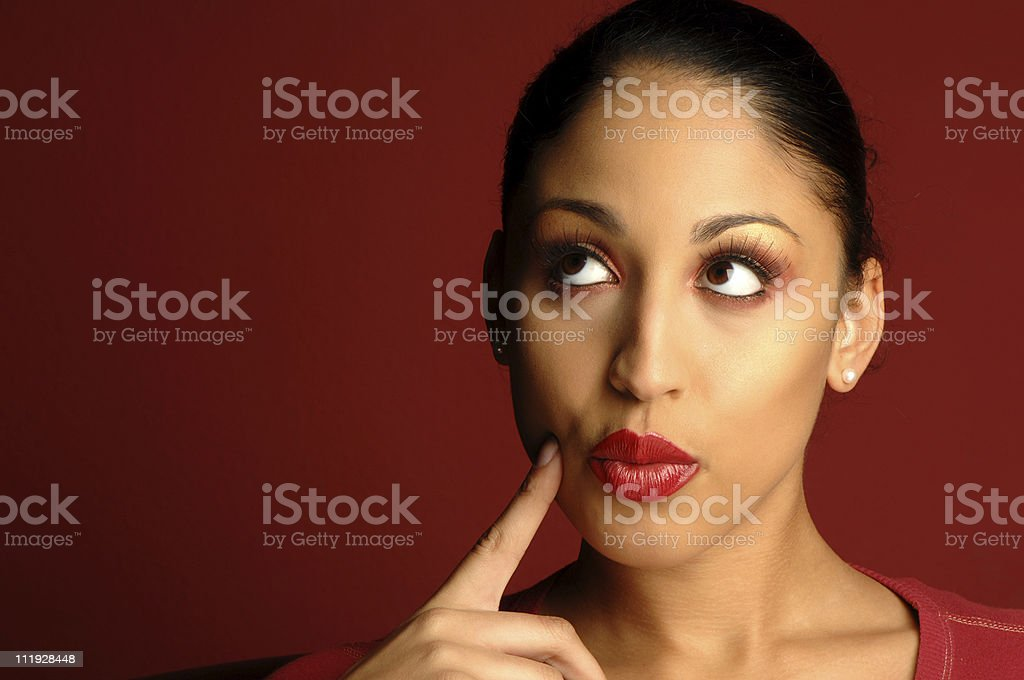 Mixed Race African American Woman Thinking on Red royalty-free stock photo