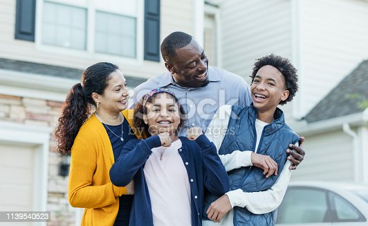 istock Mixed race African-American and Hispanic family 1139540523