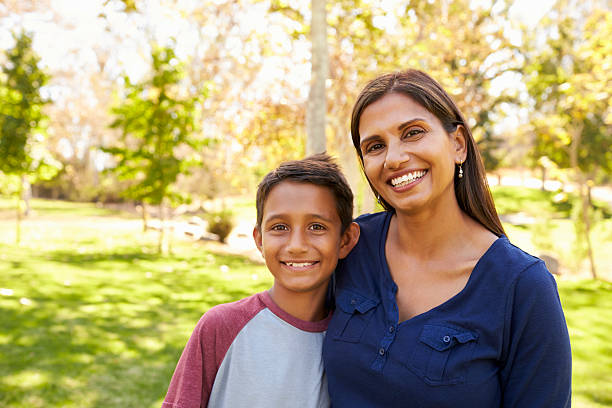 Mixed race Asian Caucasian mother and son in park, portrait stock photo