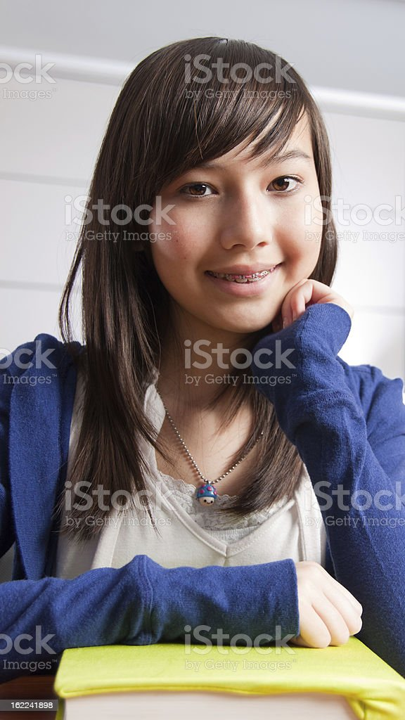 Mixed Race Asian Girl in School Classroom Studying Education royalty-free stock photo