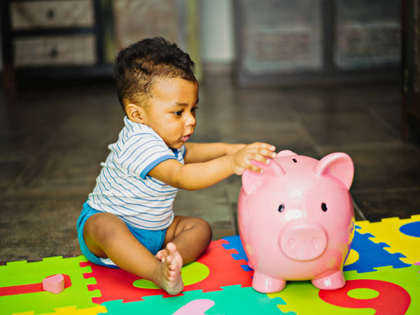 Mixed race baby playing on the floor stock photo